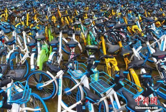 北京全面清理破损废弃共享单车,一个月回收近20万辆_亚博