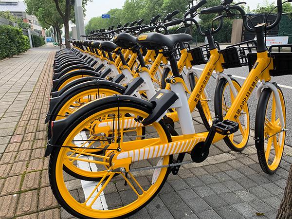 摩拜单车变黄色:在沪置换新车需用美团开锁,老用户权益不变