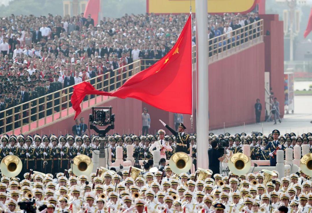 这是升国旗仪式。新华社记者 殷刚 摄